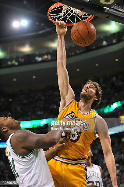 Pau Gasol of the Los Angeles Lakers dunks against Glen Davis of the Boston Celtics during the game on February 10 2011 at the TD Garden in Boston...