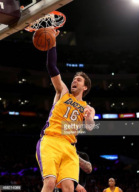 Pau Gasol of the Los Angeles Lakers dunks against the Minnesota Timberwolves at Staples Center on December 20 2013 in Los Angeles California The...