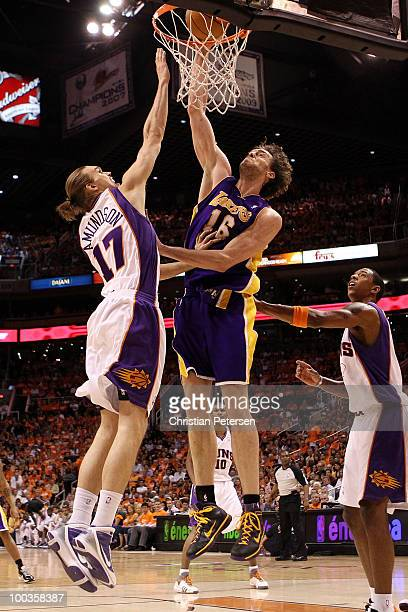 Pau Gasol of the Los Angeles Lakers dunks the ball against Louis Amundson of the Phoenix Suns in the first half of Game Three of the Western...