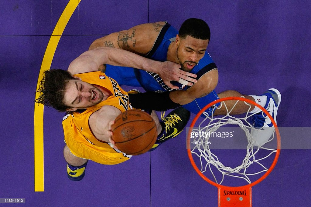 Pau Gasol #16 of the Los Angeles Lakers dunks the ball over Tyson Chandler #6 of the Dallas Mavericks in the second half in Game One of the Western Conference Semifinals in the 2011 NBA Playoffs at Staples Center on May 2, 2011 in Los Angeles, California.