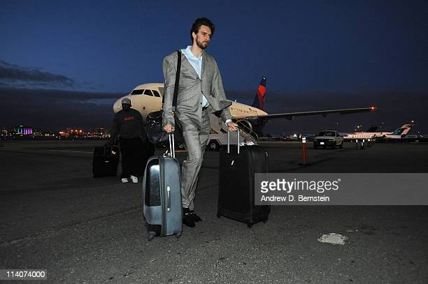 Pau Gasol of the Los Angeles Lakers exits the team plane arriving from Dallas following Game Four of the Western Conference Semifinals in the 2011...