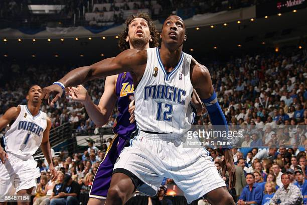 Pau Gasol of the Los Angeles Lakers fights for rebound position against Dwight Howard of the Orlando Magic in Game Five of the 2009 NBA Finals at...