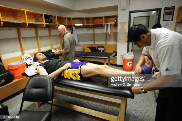 Pau Gasol of the Los Angeles Lakers gets his foot taped prior to the game against the Boston Celtics in Game Five of the 2010 NBA Finals on June 13...