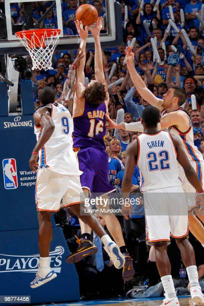 Pau Gasol of the Los Angeles Lakers gets the offensive rebound in the fourth quarter from Serge Ibaka of the Oklahoma City Thunder in Game Six of the...
