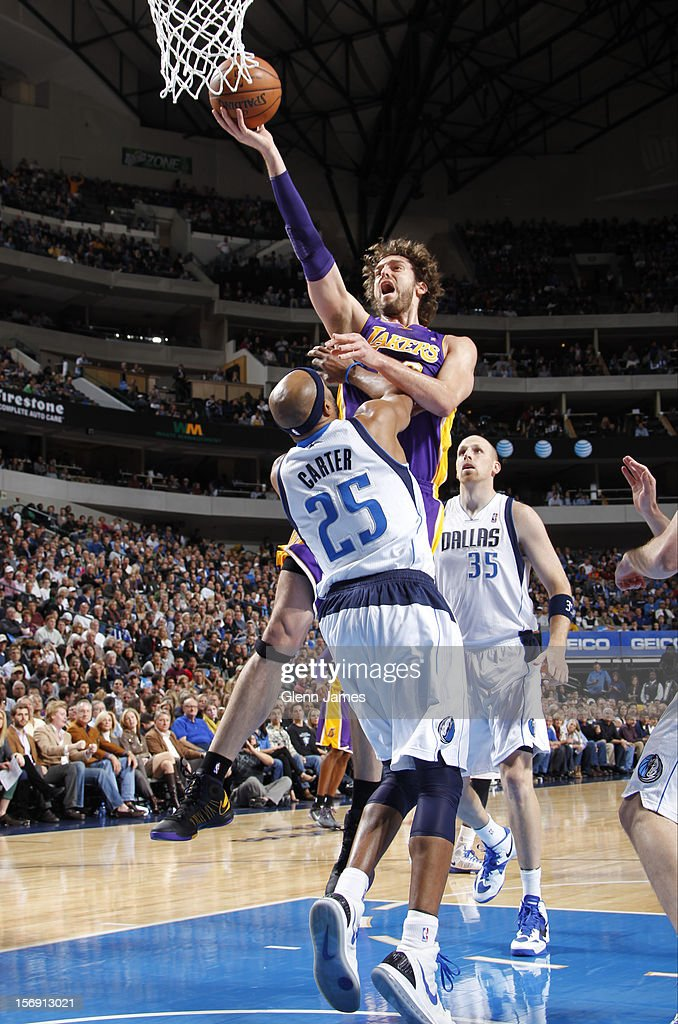 Pau Gasol #16 of the Los Angeles Lakers goes in for the layup against Vince Carter #25 of the Dallas Mavericks on November 24, 2012 at the American Airlines Center in Dallas, Texas.