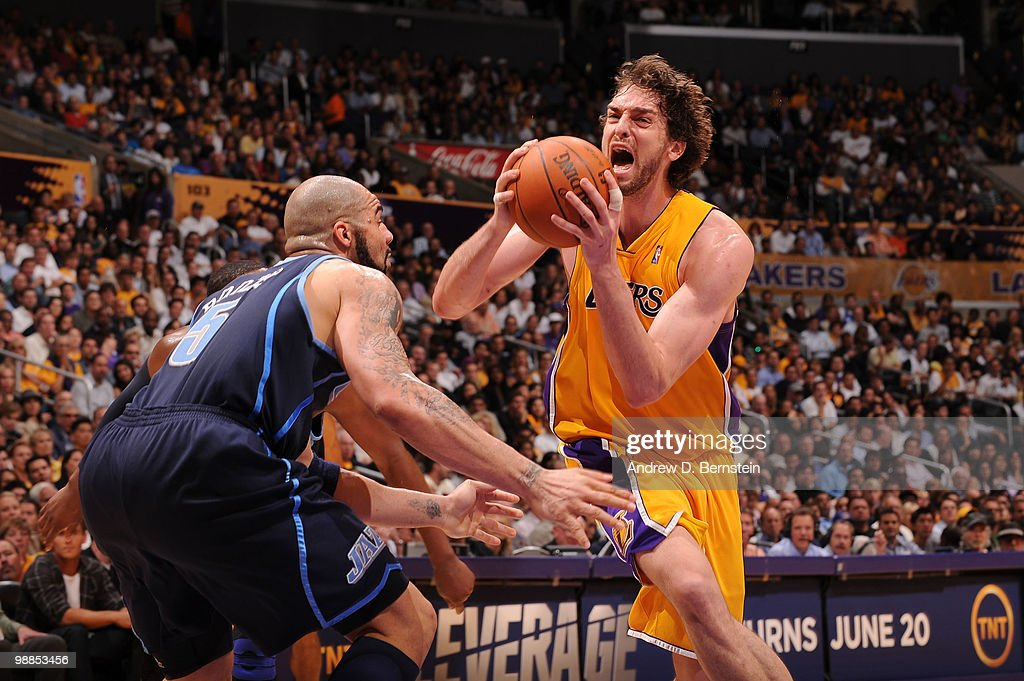 Pau Gasol #16 of the Los Angeles Lakers goes to the hoop against Carlos Boozer #5 of the Utah Jazz in Game Two of the Western Conference Semifinals during the 2010 NBA Playoffs at Staples Center on May 4, 2010 in Los Angeles, California.