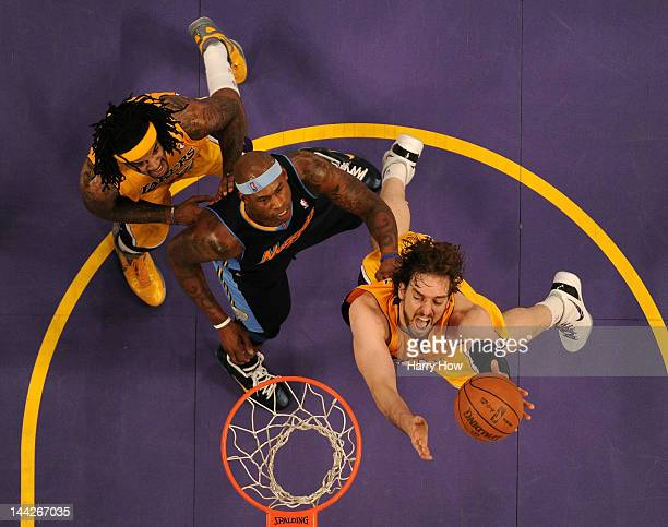 Pau Gasol of the Los Angeles Lakers goes up for a shot in the lane in the first half in front of Al Harrington of the Denver Nuggets in Game Seven of...