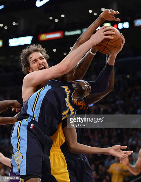 Pau Gasol of the Los Angeles Lakers grabs a rebound against Corey Brewer of the Denver Nuggets in the fourth quarter in Game Seven of the Western...