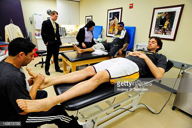 Pau Gasol of the Los Angeles Lakers has his foot checked in the locker room before playing against the Denver Nuggets in Game One of the Western...
