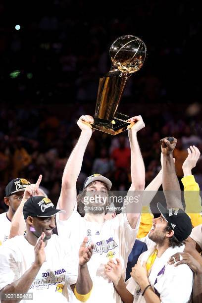 Pau Gasol of the Los Angeles Lakers holds up the Larry O'Brien trophy after the Lakers defeated the Boston Celtics in Game Seven of the 2010 NBA...