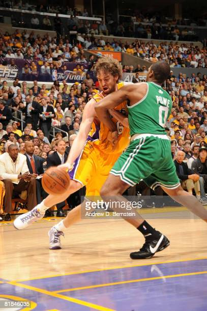 Pau Gasol of the Los Angeles Lakers is met by Leon Powe of the Boston Celtics while driving the baseline in Game Four of the 2008 NBA Finals at...