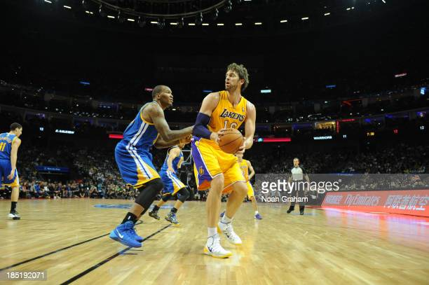 Pau Gasol of the Los Angeles Lakers looks to shoot against Marreese Speights of the Golden State Warriors during the 2013 Global Games on October 18...