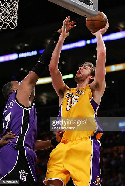 Pau Gasol of the Los Angeles Lakers puts a shot up against Sheldon Williams of the Sacramento Kings at Staples Center on April 15 2008 in Los Angeles...