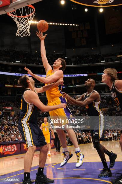Pau Gasol of the Los Angeles Lakers puts up a shot against Mehmet Okur of the Utah Jazz at Staples Center on January 25 2011 in Los Angeles...