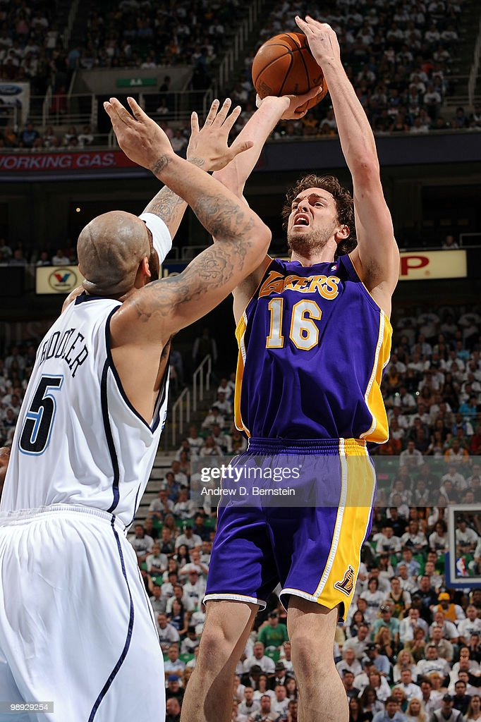 Pau Gasol #16 of the Los Angeles Lakers puts up a shot over Carlos Boozer #5 of the Utah Jazz in Game Three of the Western Conference Semifinals during the 2010 NBA Playoffs at the EnergySolutions Arena on May 8, 2010 in Salt Lake City, Utah.