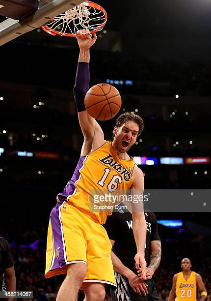 Pau Gasol of the Los Angeles Lakers reacts after dunking against the Minnesota Timberwolves at Staples Center on December 20 2013 in Los Angeles...
