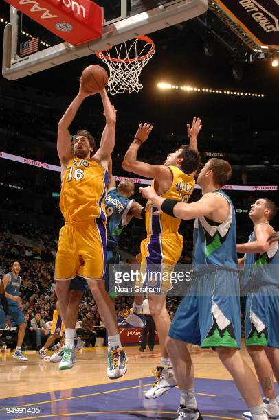 Pau Gasol of the Los Angeles Lakers rebounds the ball against Wayne Ellington of the Minnesota Timberwolves during the game on December 11 2009 at...