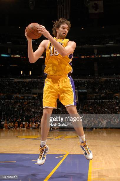 Pau Gasol of the Los Angeles Lakers rebounds the ball during the game against the Utah Jazz on December 9, 2009 at Staples Center in Los Angeles,...