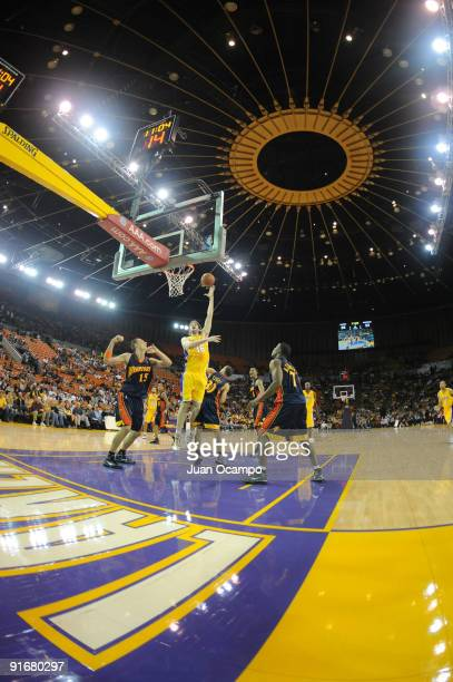 Pau Gasol of the Los Angeles Lakers shoots against Andris Biedrins Stephen Curry and Kelenna Azubuike of the Golden State Warriors during a preseason...