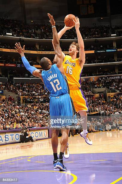 Pau Gasol of the Los Angeles Lakers shoots against Dwight Howard of the Orlando Magic at Staples Center on January 16 2009 in Los Angeles California...