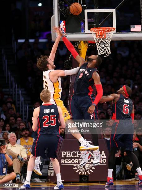 Pau Gasol of the Los Angeles Lakers shoots over Andre Drummond of the Detroit Pistons at Staples Center on November 17 2013 in Los Angeles California...