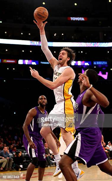 Pau Gasol of the Los Angeles Lakers shoots over Jason Thompson of the Sacramento Kings at Staples Center on November 24, 2013 in Los Angeles,...