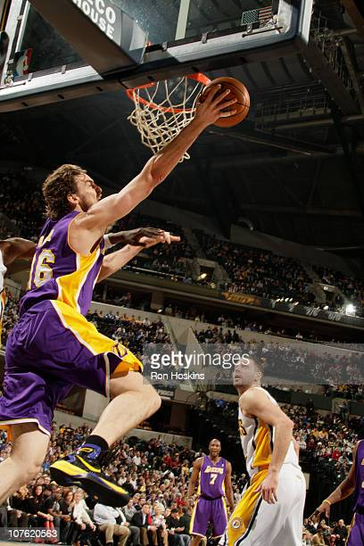 Pau Gasol of the Los Angeles Lakers shoots over Josh McRoberts of the Indiana Pacers on December 15 2010 at Conseco Fieldhouse in Indianapolis...