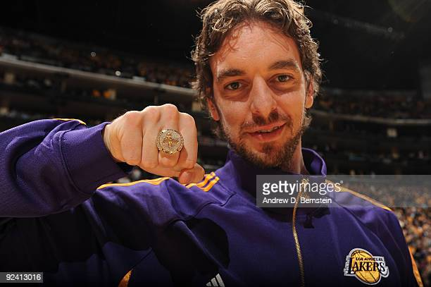 Pau Gasol of the Los Angeles Lakers shows off his 2009 NBA Championship ring before the season opener against the Los Angeles Clippers at Staples...