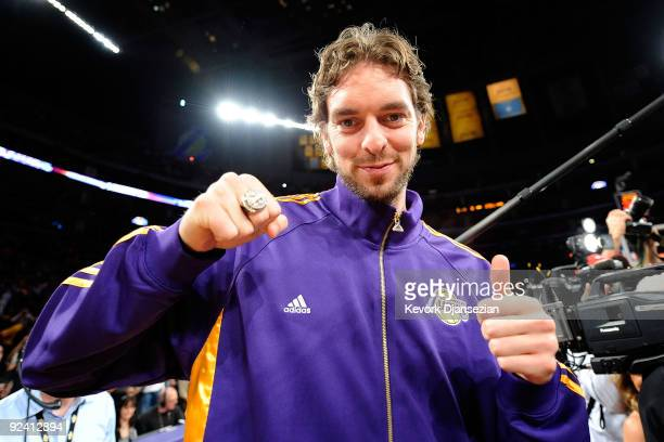 Pau Gasol of the Los Angeles Lakers smiles after receiving his championship ring before the season opening game against the Los Angeles Clippers at...