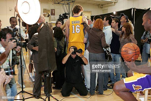 Pau Gasol of the Los Angeles Lakers speaks with the media while Kobe Bryant of the Los Angeles Lakers poses for a portrait during NBA Media Day on...
