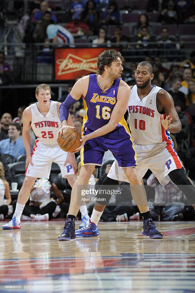 Pau Gasol #16 of the Los Angeles Lakers stops his dribble and looks to pass the ball against Greg Monroe #10 of the Detroit Pistons during the game on February 3, 2013 at The Palace of Auburn Hills in Auburn Hills, Michigan.