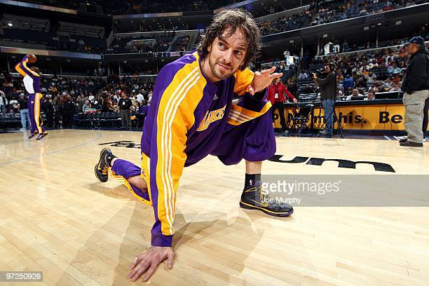 Pau Gasol of the Los Angeles Lakers stretches on the court during warmups prior to the game against the Memphis Grizzlies at the FedExForum on...