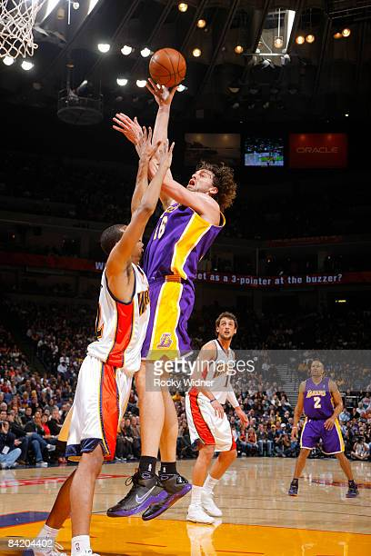 Pau Gasol of the Los Angeles Lakers takes a jump hook against Brandan Wright of the Golden State Warriors on January 07 2009 at Oracle Arena in...