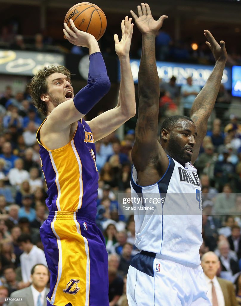 Pau Gasol #16 of the Los Angeles Lakers takes a shot against DeJuan Blair #45 of the Dallas Mavericks at American Airlines Center on November 5, 2013 in Dallas, Texas.