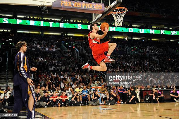Pau Gasol of the Los Angeles Lakers throws a pass to Rudy Fernandez of the Portland Trail Blazers during the Sprite Slam Dunk Contest on AllStar...