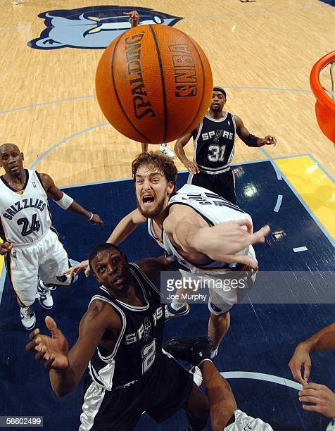 Pau Gasol of the Memphis Grizzlies and Nazr Mohammed of the San Antonio Spurs go up for a loose ball during a game between the San Antonio Spurs and...