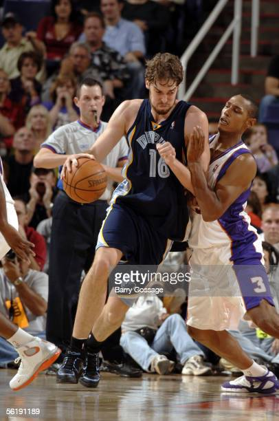 Pau Gasol of the Memphis Grizzlies battles to get into the lane against Boris Diaw of the Phoenix Suns on November 16 2005 at America West Arena in...