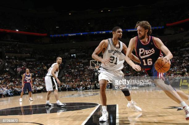Pau Gasol of the Memphis Grizzlies drives against Tim Duncan of the San Antonio Spurs at the ATT Center on April 9 2006 in San Antonio Texas NOTE TO...