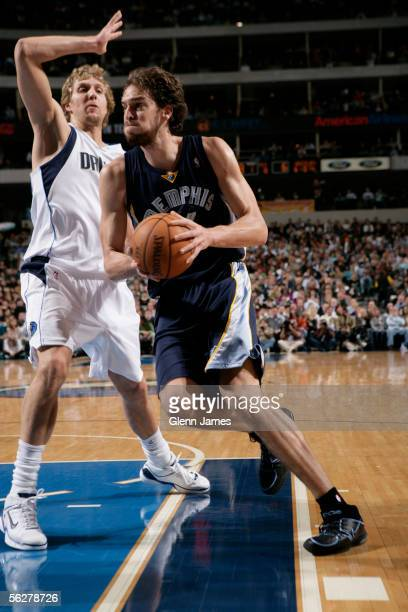 Pau Gasol of the Memphis Grizzlies drives past Dirk Nowitzki of the Dallas Mavericks November 26 2005 at American Airlines Center in Dallas Texas...
