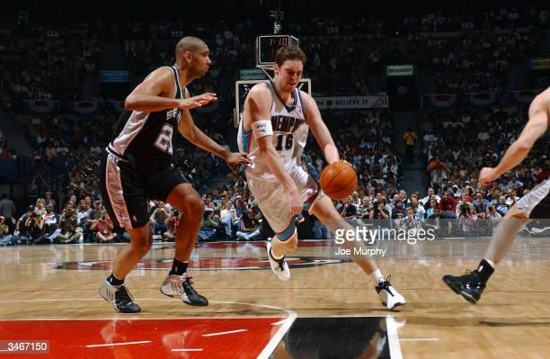 Pau Gasol of the Memphis Grizzlies drives through the lane against Tim Duncan of the San Antonio Spurs during Game four of the Western Conference...