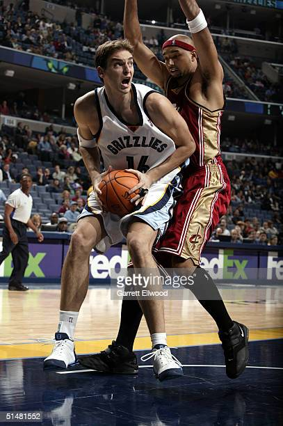 Pau Gasol of the Memphis Grizzlies drives to the basket against Drew Gooden of the Cleveland Cavaliers on October 14 2004 at the FedEx Forum in...
