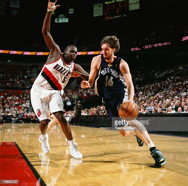 Pau Gasol of the Memphis Grizzlies drives to the basket against Zach Randolph of the Portland Trail Blazers during a game at The Rose Garden on March...