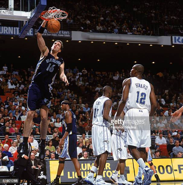 Pau Gasol of the Memphis Grizzlies dunks during a game against the Orlando Magic at TD Waterhouse Centre on December 4 2004 in Orlando Florida The...
