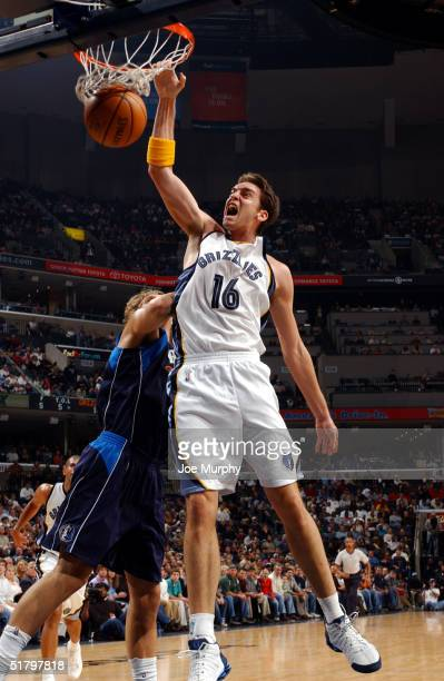 Pau Gasol of the Memphis Grizzlies dunks the ball over Dirk Nowitzki of the Dallas Mavericks on November 27 2004 at Fedex Forum in Memphis Tennessee...