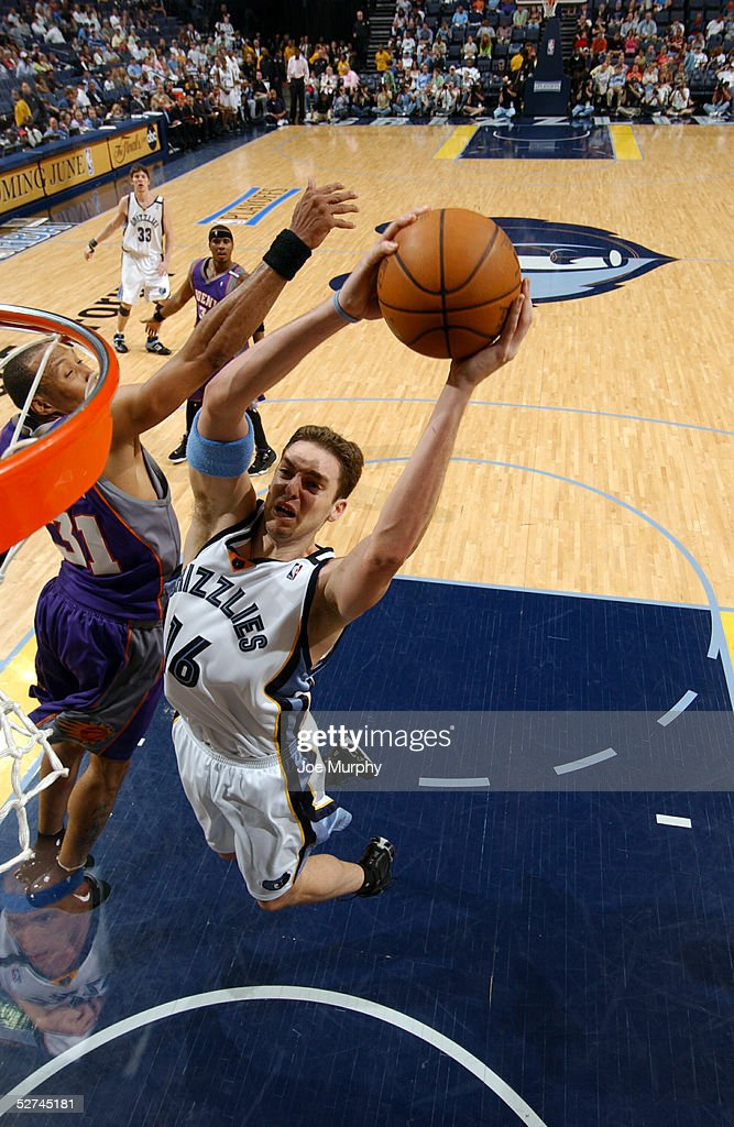 Pau Gasol #16 of the Memphis Grizzlies goes up for a dunk over Shawn Marion #31 of the Phoenix Suns in Game four of the Western Conference Quarterfinals during the 2005 NBA Playoffs on May 1, 2005 at FedExForum in Memphis, Tennessee.