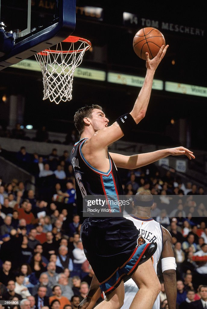 Pau Gasol #16 of the Memphis Grizzlies lays up a shot against the Golden State Warriors during the game on January 12, 2004 at the Arena in Oakland, California. The Grizzlies won 115-113 in double overtime.