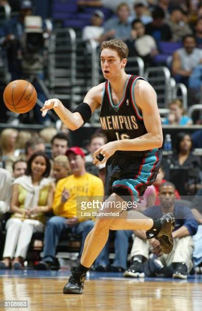 Pau Gasol of the Memphis Grizzlies passes during the game against the Los Angeles Clippers at Staples Center on March 6 2004 in Los Angeles...