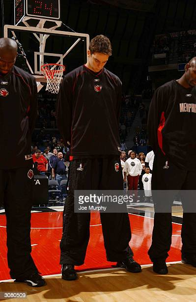 Pau Gasol of the Memphis Grizzlies pauses for a moment of silence in honor of the victims of terrorism in Spain before a game against the Los Angeles...