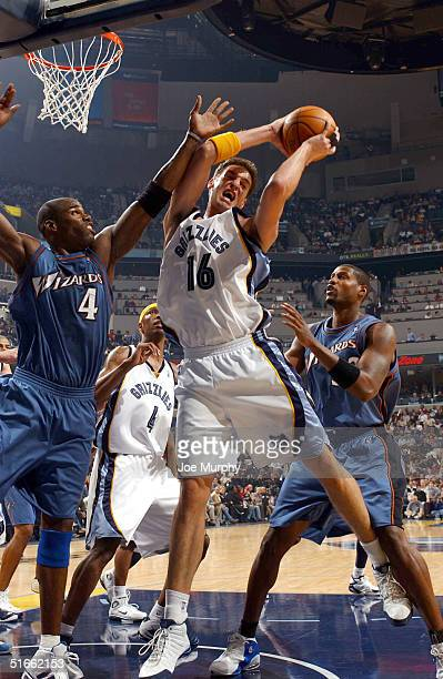 Pau Gasol of the Memphis Grizzlies pulls down a rebound over Antawn Jamison of the Washington Wizards during a game at Fedex Forum on Novemeber 3,...