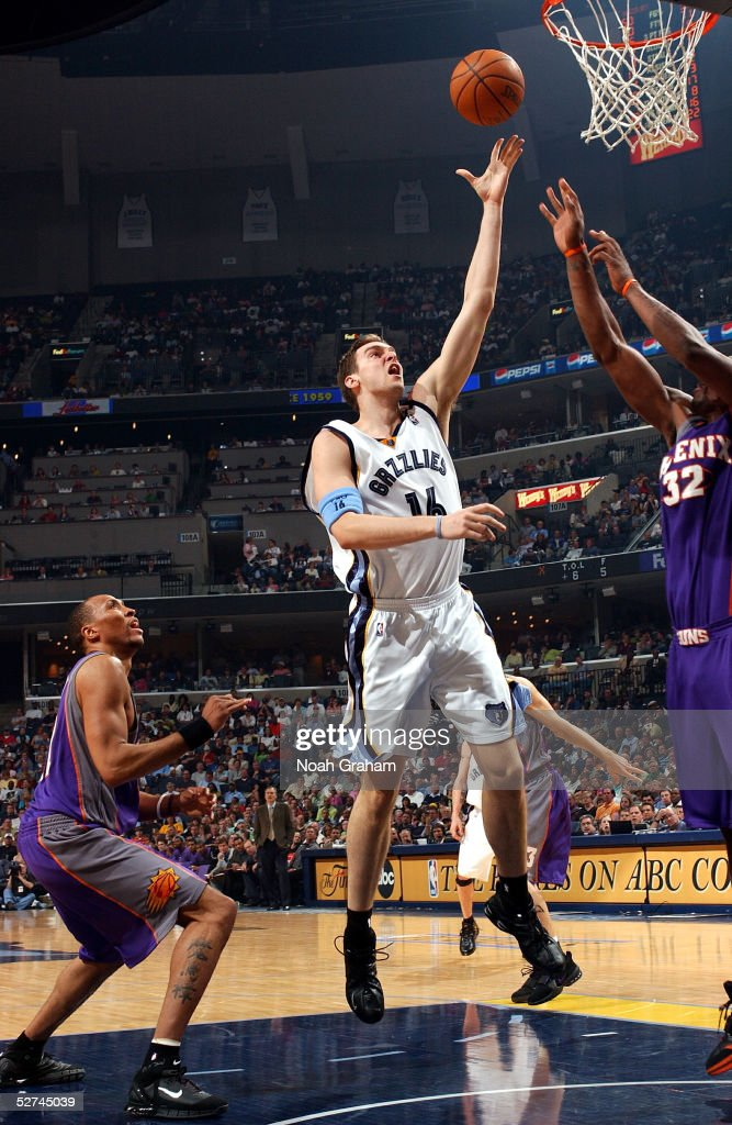 Pau Gasol #16 of the Memphis Grizzlies puts up a shot in the lane over Amare Stoudemire #32 of the Phoenix Suns in Game four of the Western Conference Quarterfinals during the 2005 NBA Playoffs on May 1, 2005 at FedExForum in Memphis, Tennessee. The Suns defeated the Grizzlies 123-115.